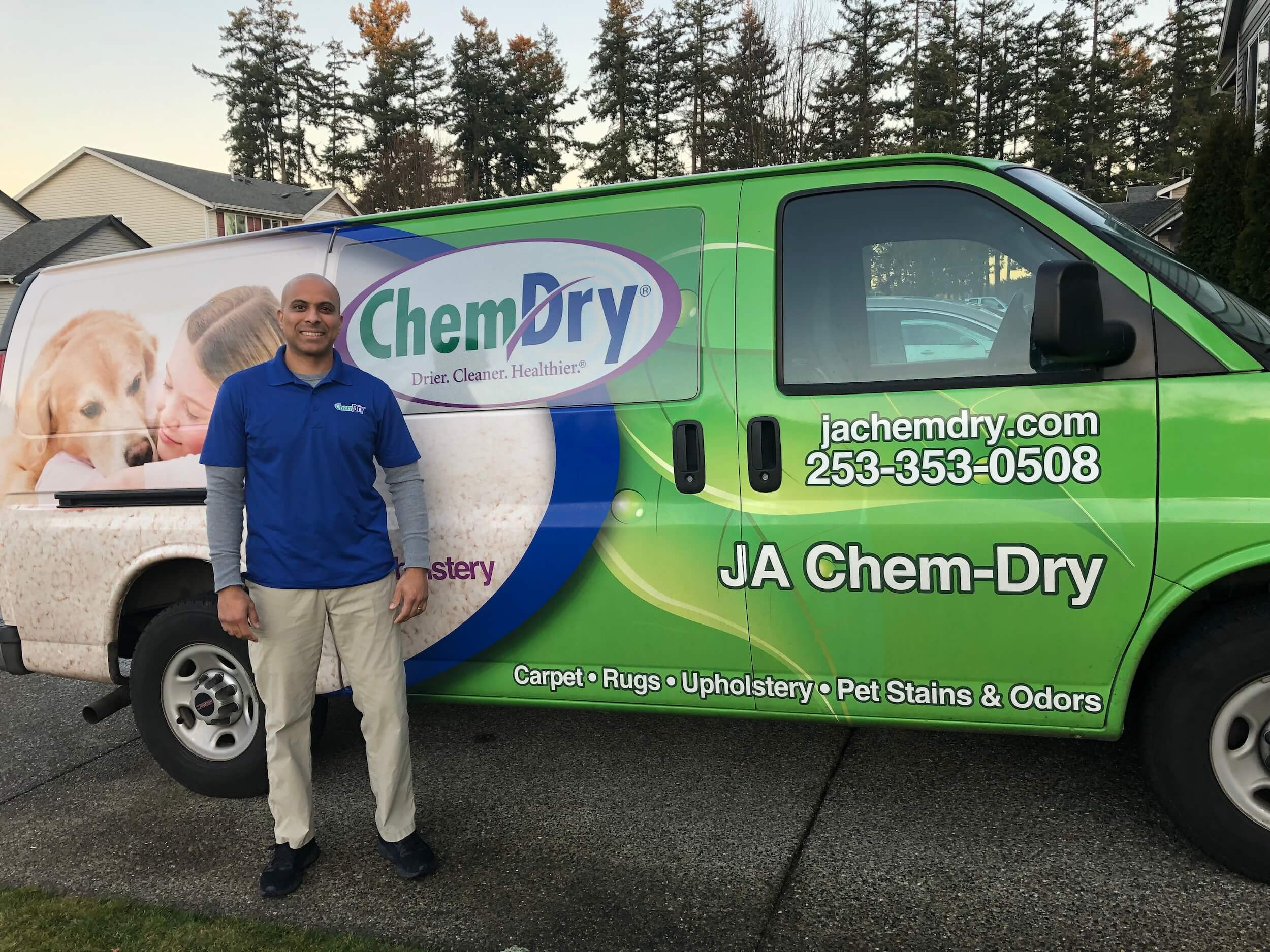 JA Chem-Dry service van and technician preparing for carpet cleaning service